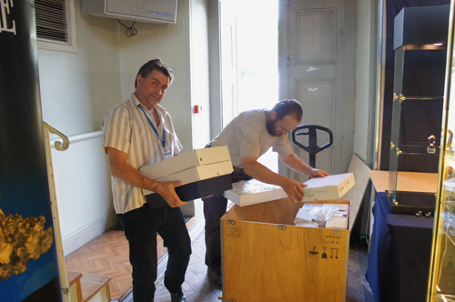 Dave Whipp and Gael unloading one of the six crates that arrived from Gilles Emringer's home, full of great French mineral specimens.