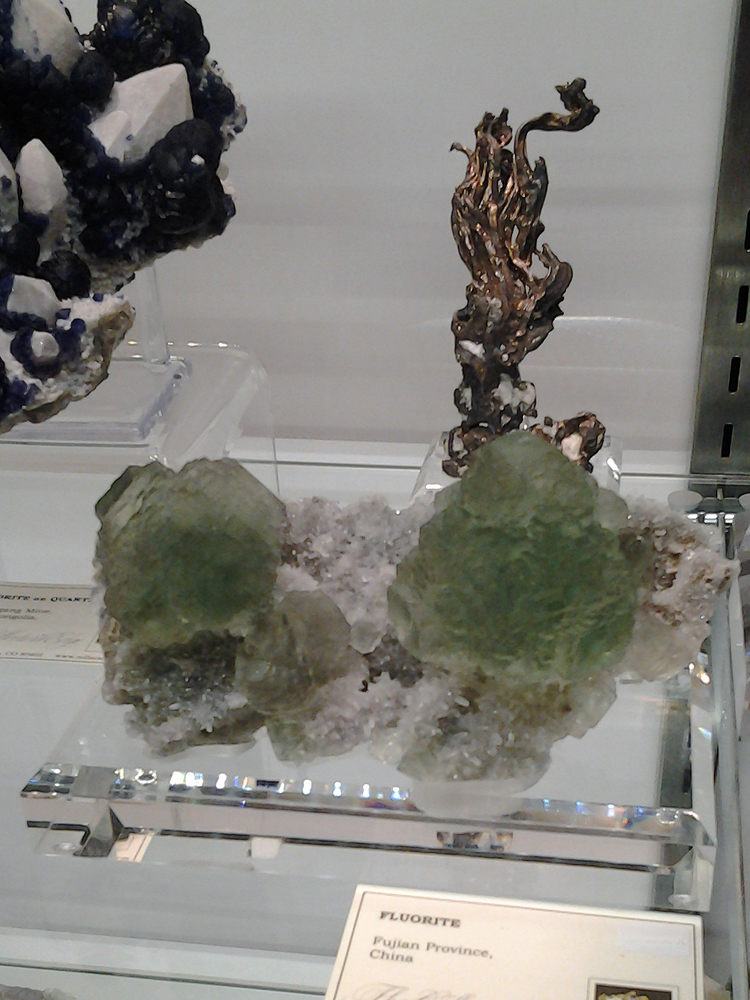 New green Fluorite from Fujian Province, China in  octahedral crystals with heavily stepped growth.