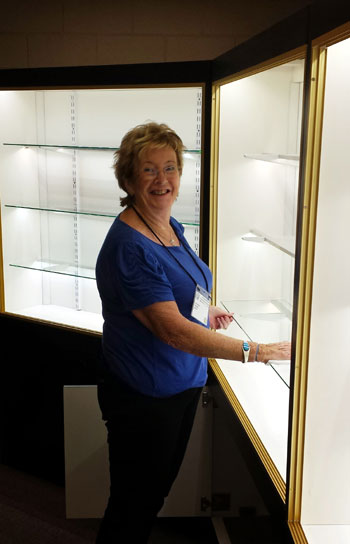 ...but first the cabinets had to be cleaned - Liz Hacker on glass cleaning duty!