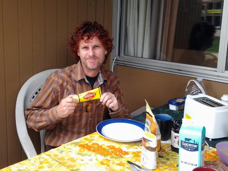 Australian dealer Tony Fraser enjoys his breakfast outside his room, bringing the all important supply of vegemite.