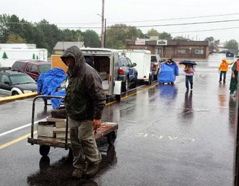 unloading in the rain