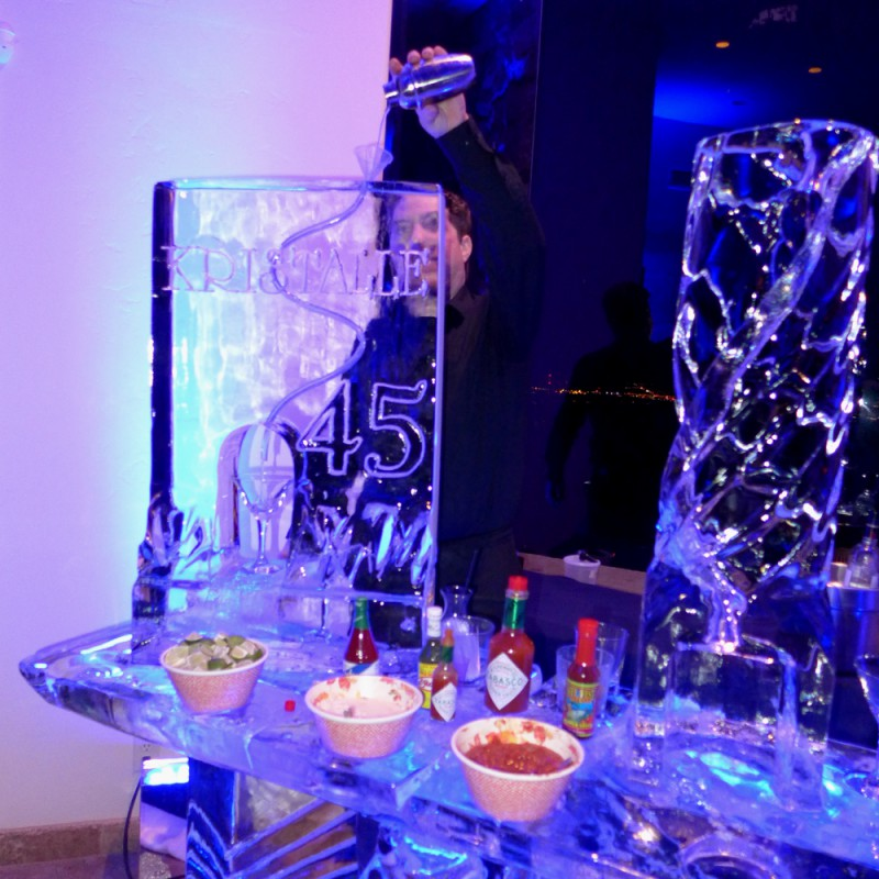 The martini and oyster luge ice bar was a huge hit! The ice sculpture lasted another three days in the yard. Thanks to the very talented Ray.
