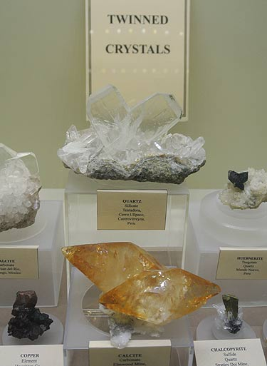 Twin crystals of different minerals on display at the Springfield show 2013