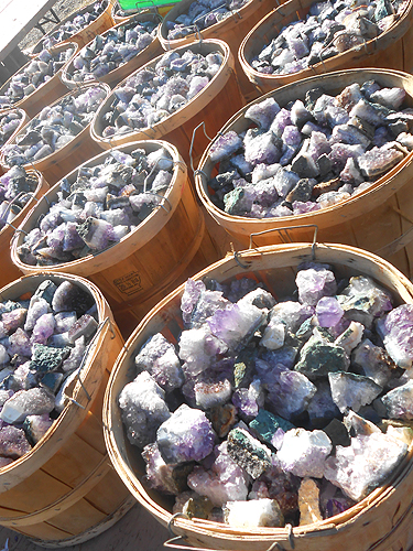 "Tubs of Amethyst from Brazil. Specimens reaching 3"" and 4"" across."