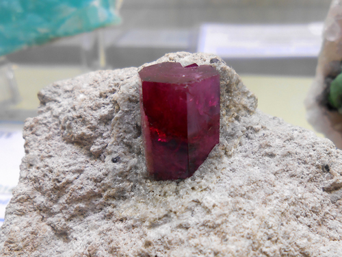 A beautifully preserved, deep crimson coloured flat topped hexagonal Red Beryl crystal from the Violet claims, Wah Wah Mts, Beaver Co., Utah, USA.