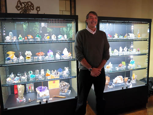 Kevin Brown smiles for the photo in front of his collection