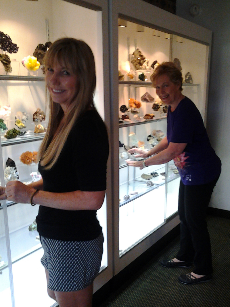 Lois Nelson and Roberta McCarty set up the show cases in the Kristalle room