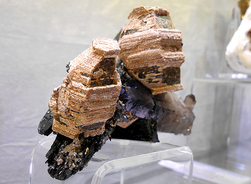 Pagoda shaped Parisite crystals perched on Smoky Quartz and Aegirine from Mount Malosa, Zomba, Malawi.