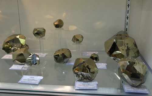 A selection of extremely well crystallized specimens of Pyrite showing complex form and an almost mirror polish on some of the faces, from the Merelani Hills, Arusha Region, Tanzania.