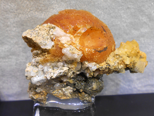 A partial spherical aggregate of Stilbite from La Lauziere Massif, Savoie, Rhone Alpes, France.
