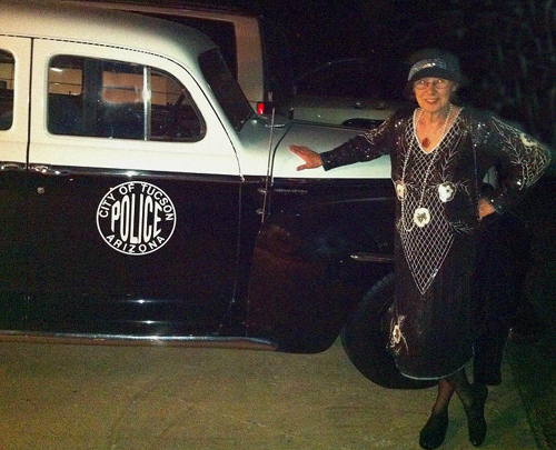 Frances Flynn in her amazing original 20's dress took a fancy to the police car.