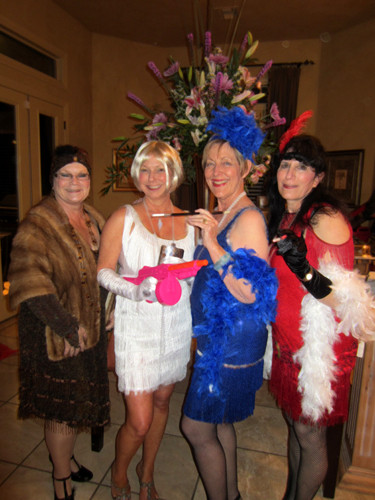The ladies of the house in their stunning flapper dresses.