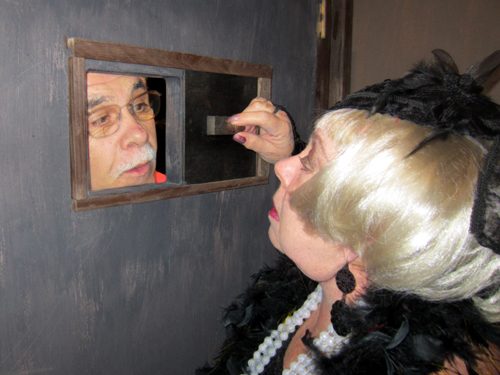 Not everybody is allowed to enter the speakeasy, so Dona checks carefully who is knocking on the door.