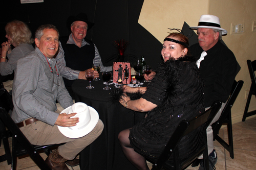 Scott Werschky, Allen Arnold, Paul Melville and Trish from Australia enjoying each other's company at the party.