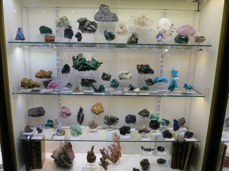 A selection of mineral specimens including some lovely crystallised Coppers on the bottom shelf, and a large Malachite after Azurite from Tsumeb on the second from top shelf