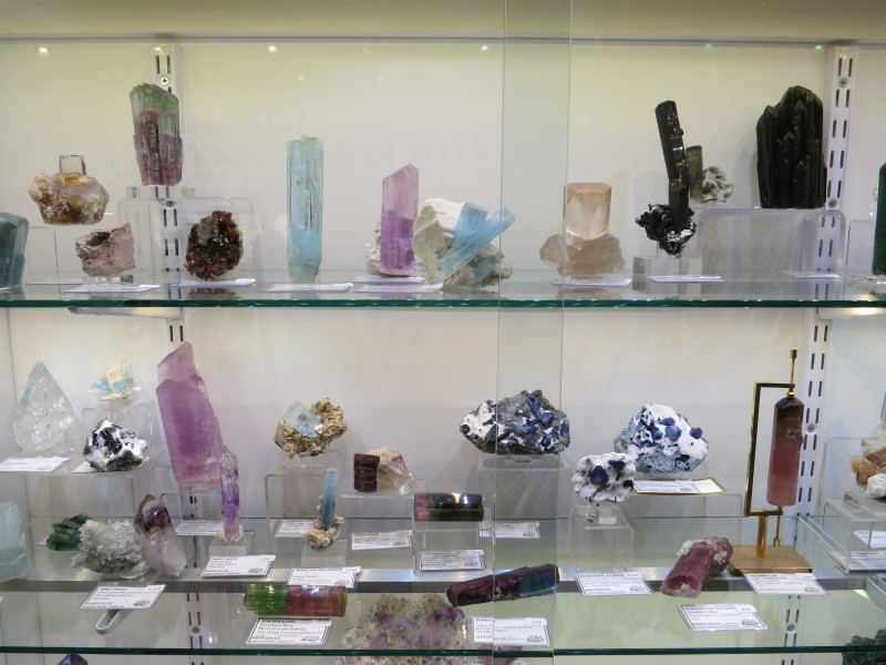 A display of Gem minerals - blue Aquamarines, pink Kunzites, colourful Tourmalines